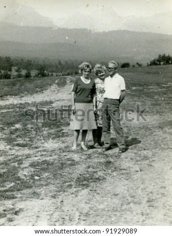 Vintage photo of family outdoor (fifties) - stock photo