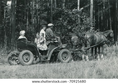 Vintage photo of family traveling in horse-drawn carriage (sixties)