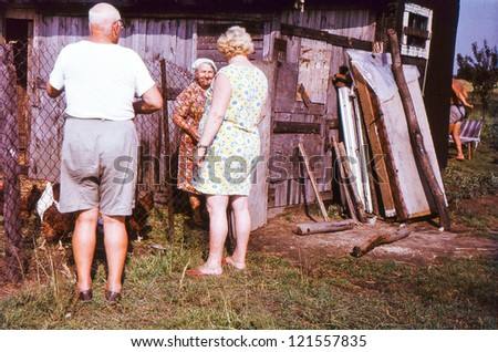 Vintage photo of farmers family (seventies) - stock photo