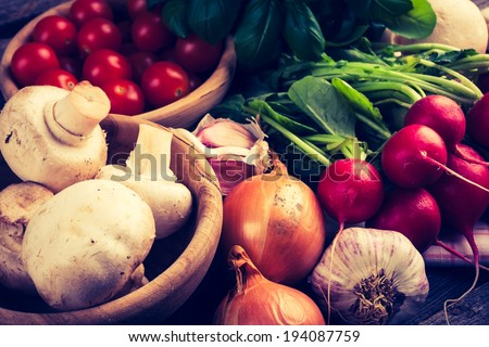 vintage photo of fresh vegetables on wooden table - stock photo