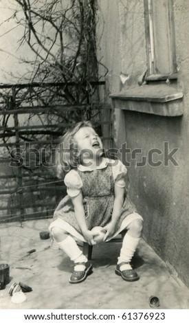 Vintage photo of girl (fifties) - stock photo