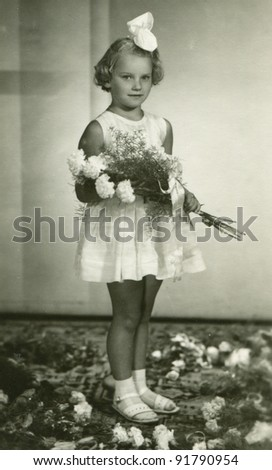 Vintage photo of girl - first communion (sixties) - stock photo