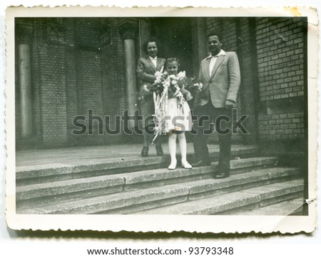 Vintage photo of girl with parents - First Communion (fifties) - stock photo