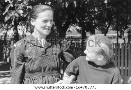 Vintage photo of grandmother and granddaughter, early sixties - stock photo