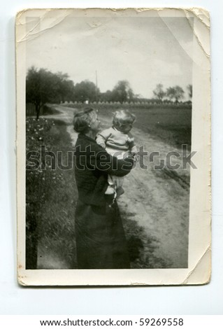 Vintage photo of grandmother and grandson - stock photo