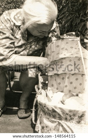 Vintage photo of grandmother and her baby granddaughter (eighties) - stock photo