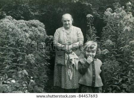 Vintage photo of grandmother with granddaughter (fifties)