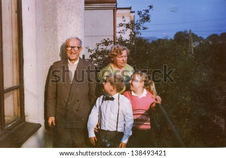 Vintage photo of grandparents with grandchildren (eighties)  - stock photo