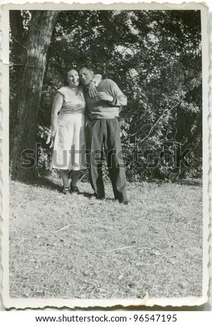 Vintage photo of happy couple (fifties) - stock photo