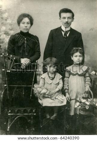 Vintage photo of happy family - stock photo