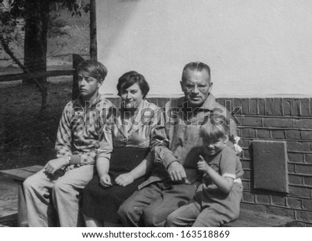 Vintage photo of happy family (fifties)