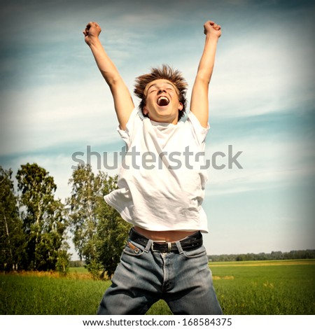 Vintage photo of Happy teenager jumping on the meadow - stock photo
