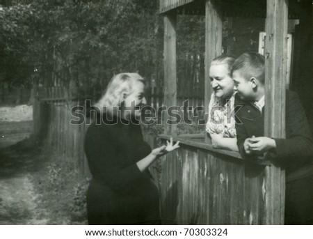 Vintage photo of happy three generations family - stock photo