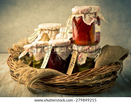 Vintage photo of homemade preserved vegetables in jars. studio shot - stock photo
