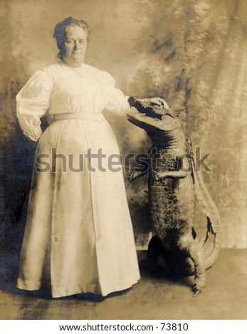 Vintage photo of large woman with stuffed alligator - stock photo
