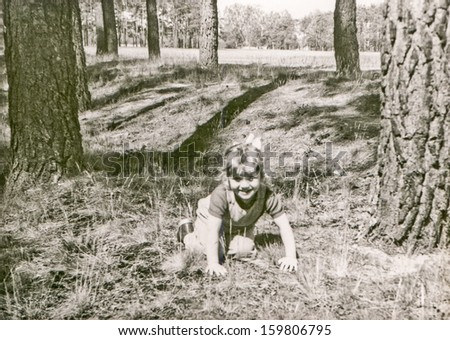 Vintage photo of little girl in forest (fifties)