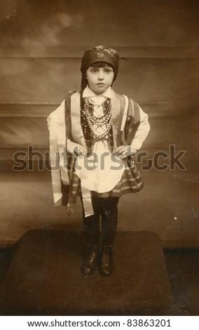 Vintage photo of little girl in traditional Polish attire (twenties) - stock photo