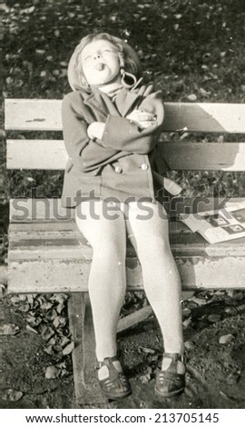 Vintage photo of little girl sticking her tongue out (fifties) - stock photo