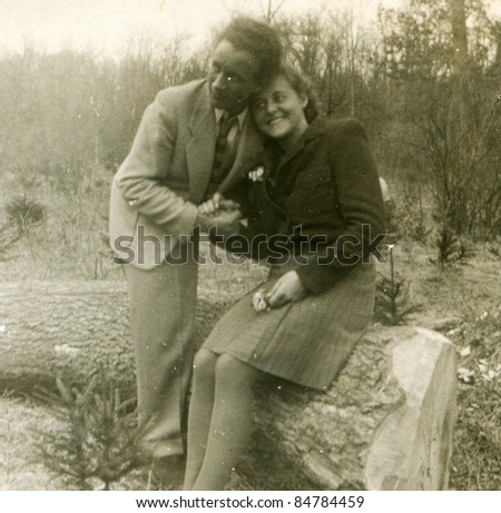 Vintage photo of loving couple (forties) - stock photo