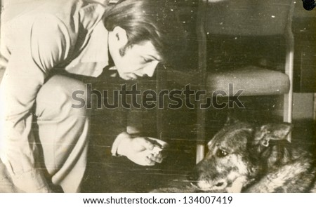 Vintage photo of man and dog (seventies) - stock photo