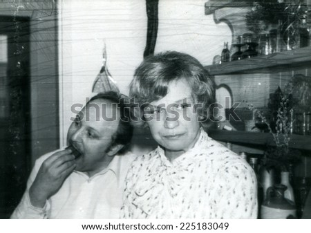 Vintage photo of man and woman during a family party, seventies - stock photo