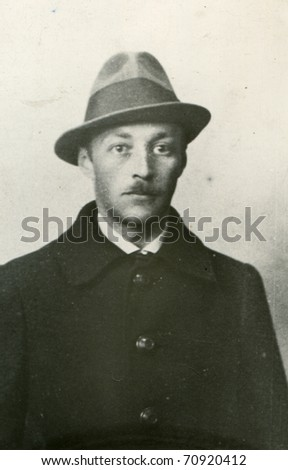 Vintage photo of man in hat (thirties) - stock photo