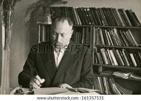Vintage photo of man in his office (fifties) - stock photo