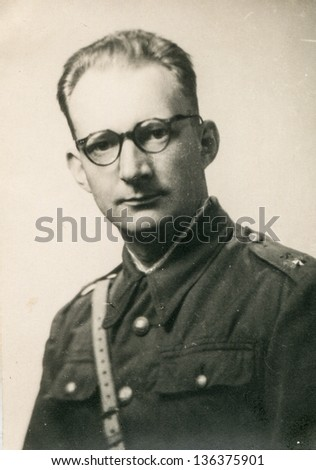 Vintage photo of man in military uniform, forties - stock photo