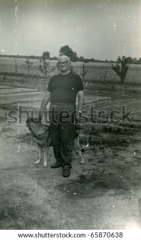 Vintage photo of man with a dog - sixties - stock photo
