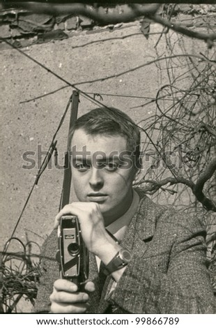 Vintage photo of man with camcorder (sixties) - stock photo