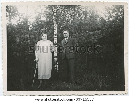 Vintage photo of mature couple outdoor (fifties) - stock photo