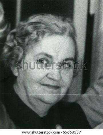 Vintage photo of mature woman (fifties) - stock photo