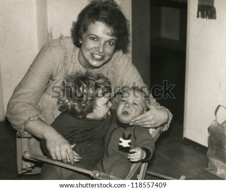 Vintage photo of mother and children (eighties) - stock photo