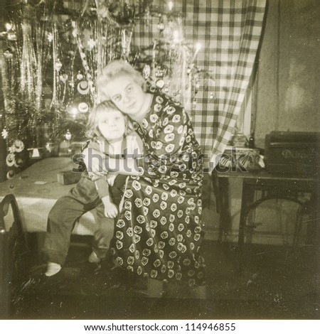 Vintage photo of mother and daughter during Christmas (fifties) - stock photo