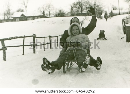 Vintage photo of mother and daughter enjoying winter (fifties)