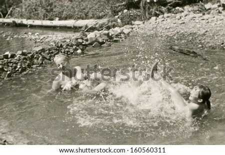 Vintage photo of mother and daughter in swimming pool, sixties - stock photo