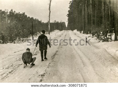 Vintage photo of mother and daughter in winter, 1950's - stock photo