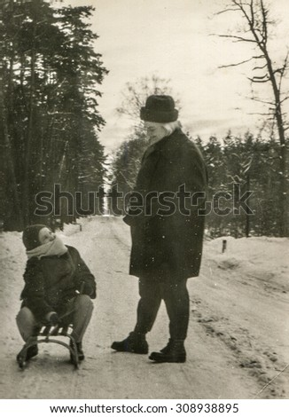 Vintage photo of mother and daughter in winter, 1950's