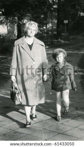 Vintage photo of mother and daughter (lately fifties) - stock photo