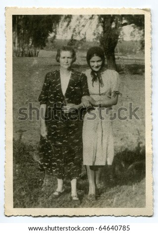 Vintage photo of mother and daughter (thirties) - stock photo