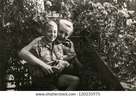 Vintage photo of mother and son on balcony (fifties)
