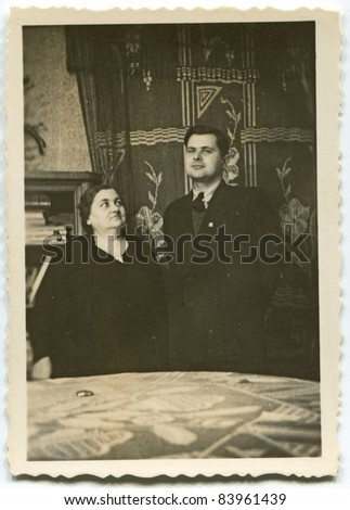 Vintage photo of mother and son (thirties) - stock photo