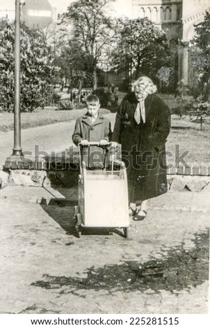 Vintage photo of mother and son with a pram - stock photo