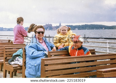 Vintage photo of mother with daughter and son, early eighties - stock photo