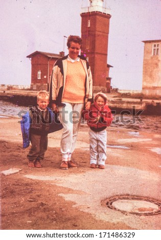 Vintage photo of mother with little children, early eighties
