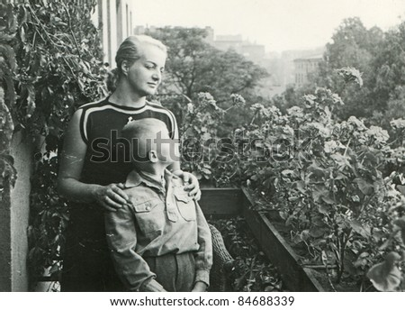 Vintage photo of mother with son (fifties)