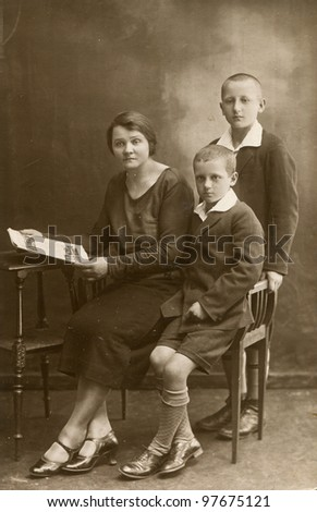 Vintage photo of mother with sons (1928) - stock photo