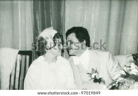 Vintage photo of newlyweds (seventies) - stock photo