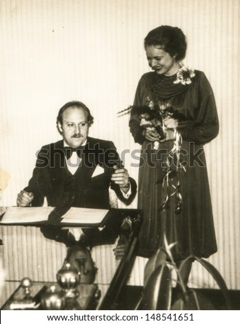 Vintage photo of newlyweds signing a contract, 1979 - stock photo