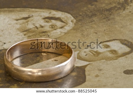 Vintage photo of newlyweds with ancient ring - stock photo